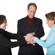 Business teamwork - hands together - Stock Photo