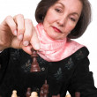 Business woman playing chess — Stock Photo