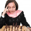 Business woman planning her next move - chess — Stock Photo