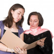 Business women discussing notes - Foto Stock