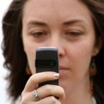 Camera phone girl - focus on phone — Stock Photo