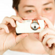 Girl with cell camera phone - focus on mobile - Stock Photo