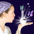 Beautiful girl blowing butterflies - mind reader - Stock Photo