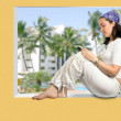 Beautiful girl reading in a tropical resort — Stock Photo #7634179