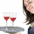 Casual smiling woman holding a wine tray — Stock Photo