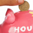 British pound in piggy bank — Stock Photo