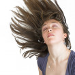Beautiful fashionable woman with moving hair — Stock Photo