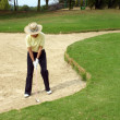 Royalty-Free Stock Photo: Golfer in bunker