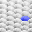 Blue golf ball amongst many others - Stock Photo