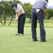Couple of golfers 2 — Stock Photo #7634620