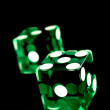 Green dices on black — Stock Photo