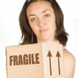 Box and girl - moving — Stockfoto