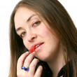 Stock Photo: Girl applying lipstick