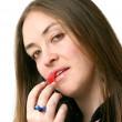 Girl applying lipstick — Stock Photo