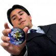 Business man catching the world - Stock Photo