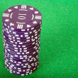 Blue pile of casino chips over green — Stockfoto