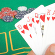 Stock Photo: Casino chips and cards showing a royal flush