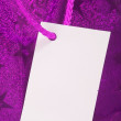 Purple tag on present — Stock Photo
