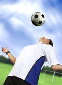 Footballer chesting the ball — Stock Photo