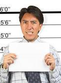 Angry business male mugshot — Stock Photo
