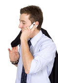 Business man smiling on mobile phone — Stock Photo