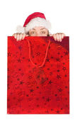Beautiful girl coming out of christmas bag — Stock Photo