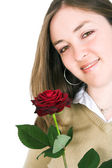 Beautiful girl holding a rose — Stock Photo