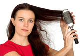 Beautiful female model combing her hair — Stock Photo