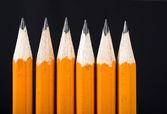 Black pencils in a row — Стоковое фото