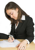 Business woman signing papers — Stok fotoğraf
