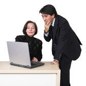 Business couple with laptop over white 2 — Stock Photo