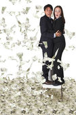 Business couple with lots of money — Stock Photo