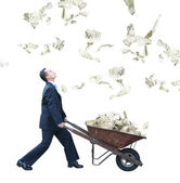 Business man collecting money — Stock Photo