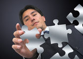 Business man arranging puzzle — Stock Photo