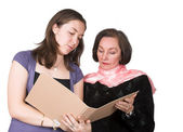 Business women discussing notes — Stock Photo