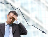 Business worries with graph — Stock Photo