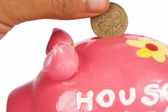 British pound in piggy bank — Stockfoto