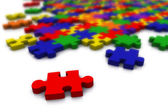 Colour puzzle - only red piece in focus — Stock Photo
