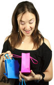 Girl looking at present inside - gift bags — Stock Photo