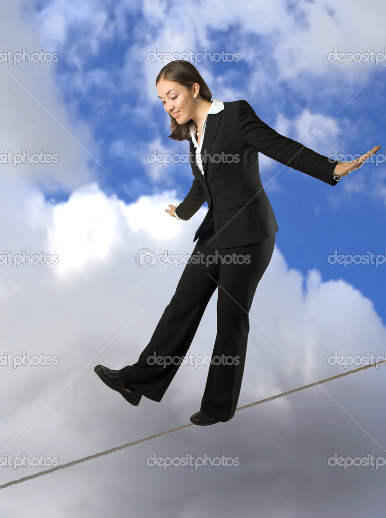 Beautiful business woman balancing on rope with the sky at the background — Stock Photo #7633527