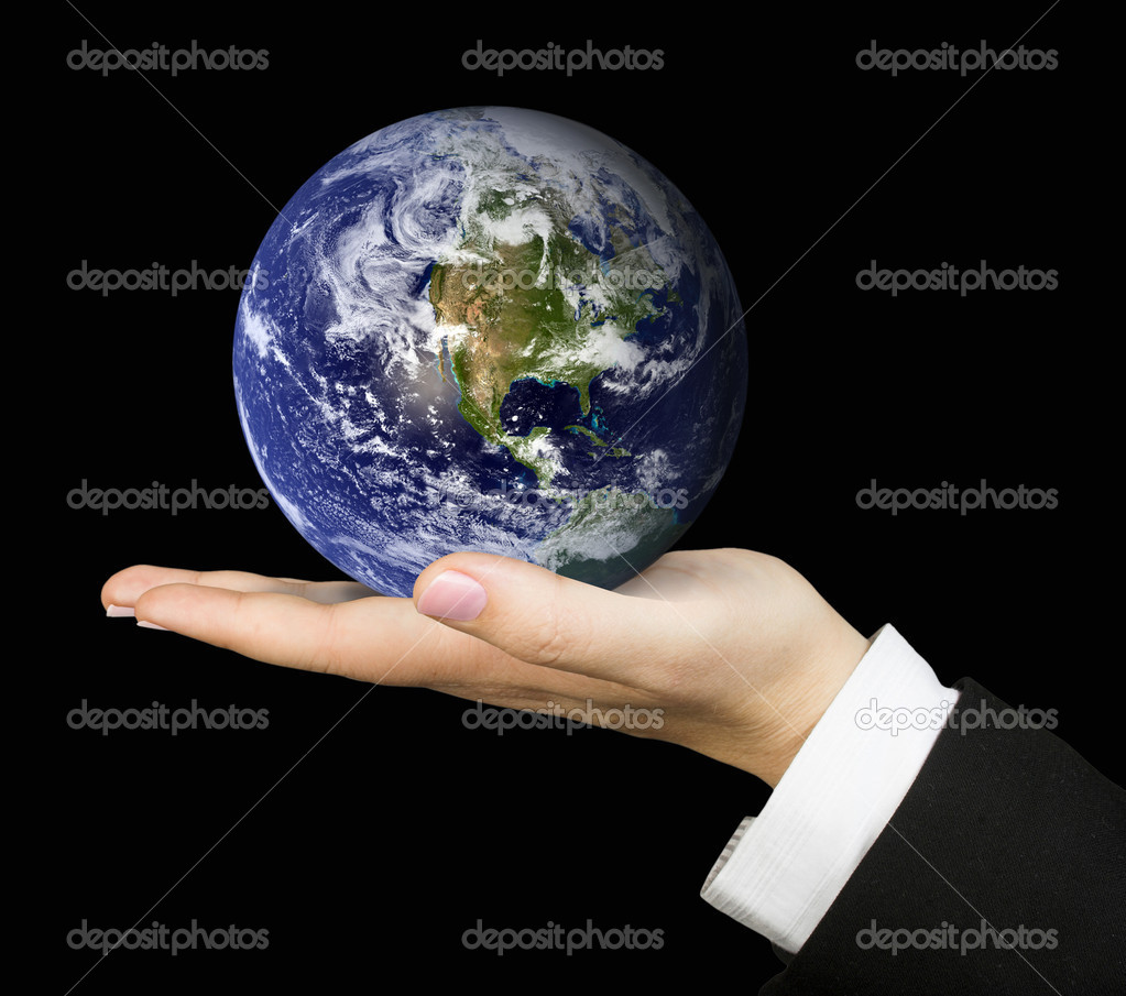 Business hand holding globe over a black background — Stock Photo #7633690