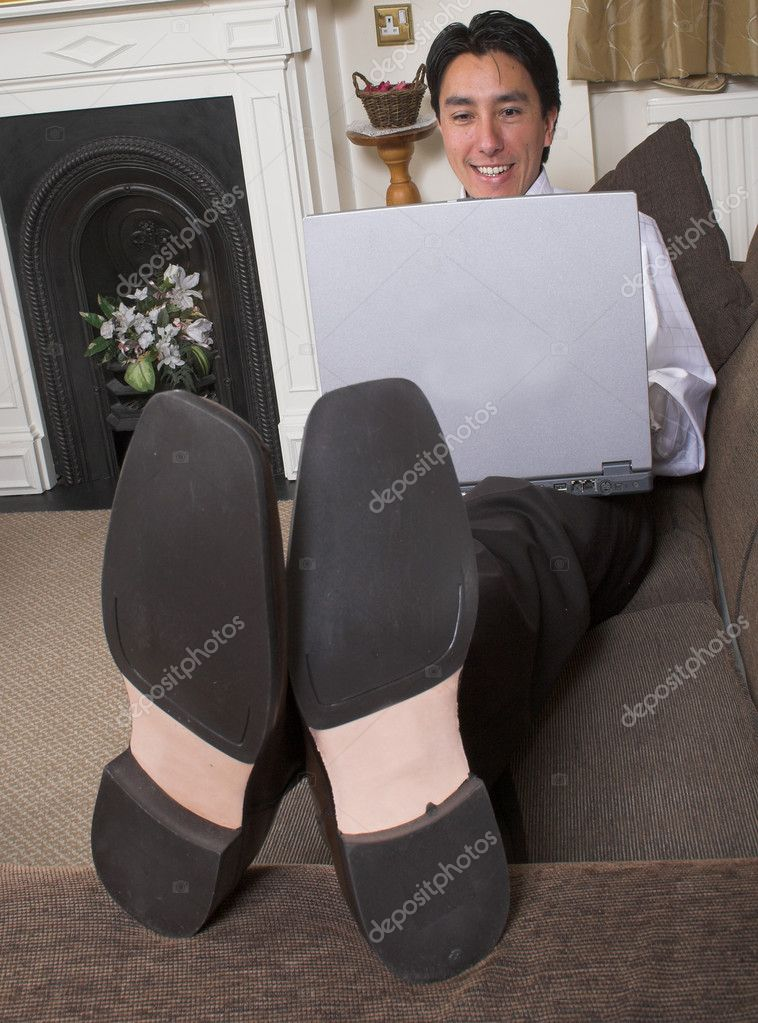 Business man on a sofa with a laptop — Stock Photo #7633791