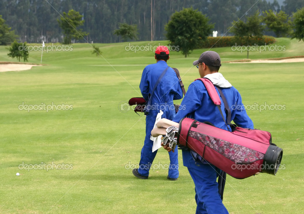 Caddies on a golf course  Stock Photo #7634121