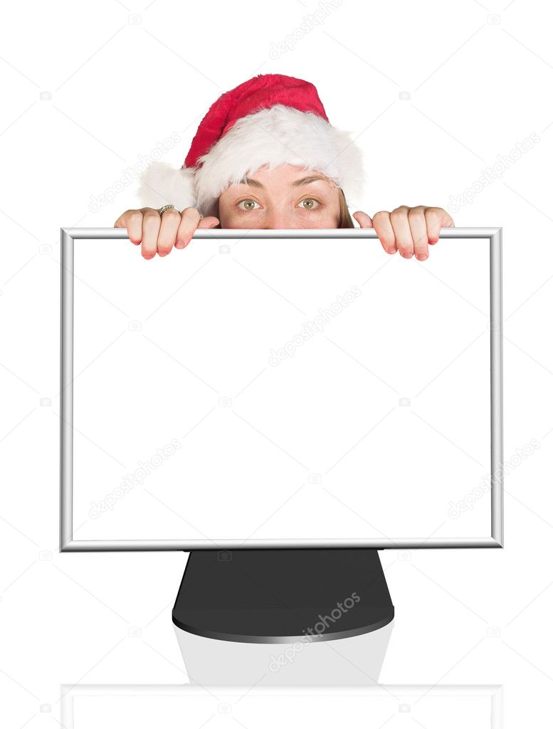 Beautiful Christmas woman peeping out of computer monitor  Stock Photo #7634233