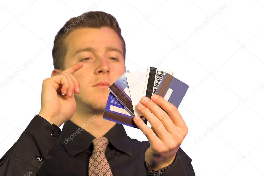 Business man chossing what credit card to pay with  Stock Photo #7634413