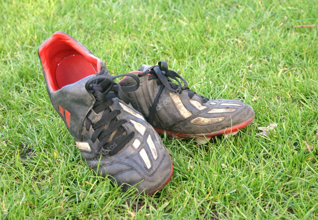 Pair of football boots after a match  Stock Photo #7634524
