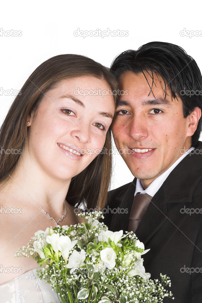 Bride and groom portait with flowers over a white background — Stock Photo #7634814