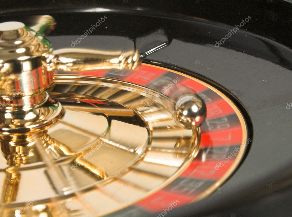 Casino roulette in motion with ball moving also — Stock Photo #7634973