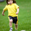Happy kid playing football — Stock Photo