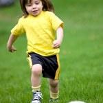 Happy kid playing football — Stock Photo #7642636
